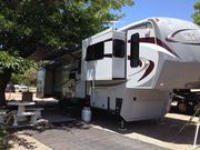 RV 42 ft 5th wheel/front living rm/5 slide outs/2 fireplaces/generator